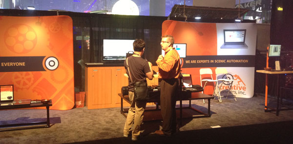 Creative Conners at LDI 2012 - Gareth speaking with an attendee.
