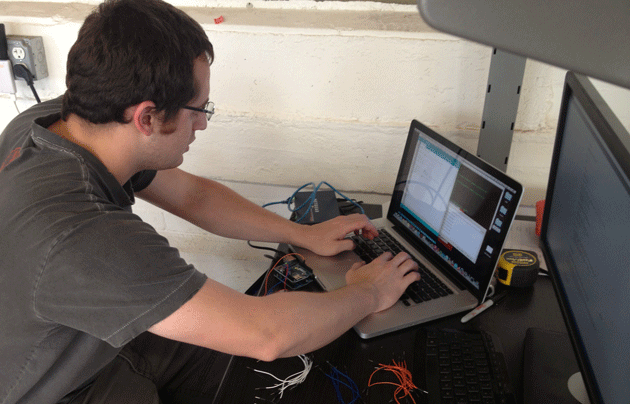 image of Jon Haupt working on Arduino programming